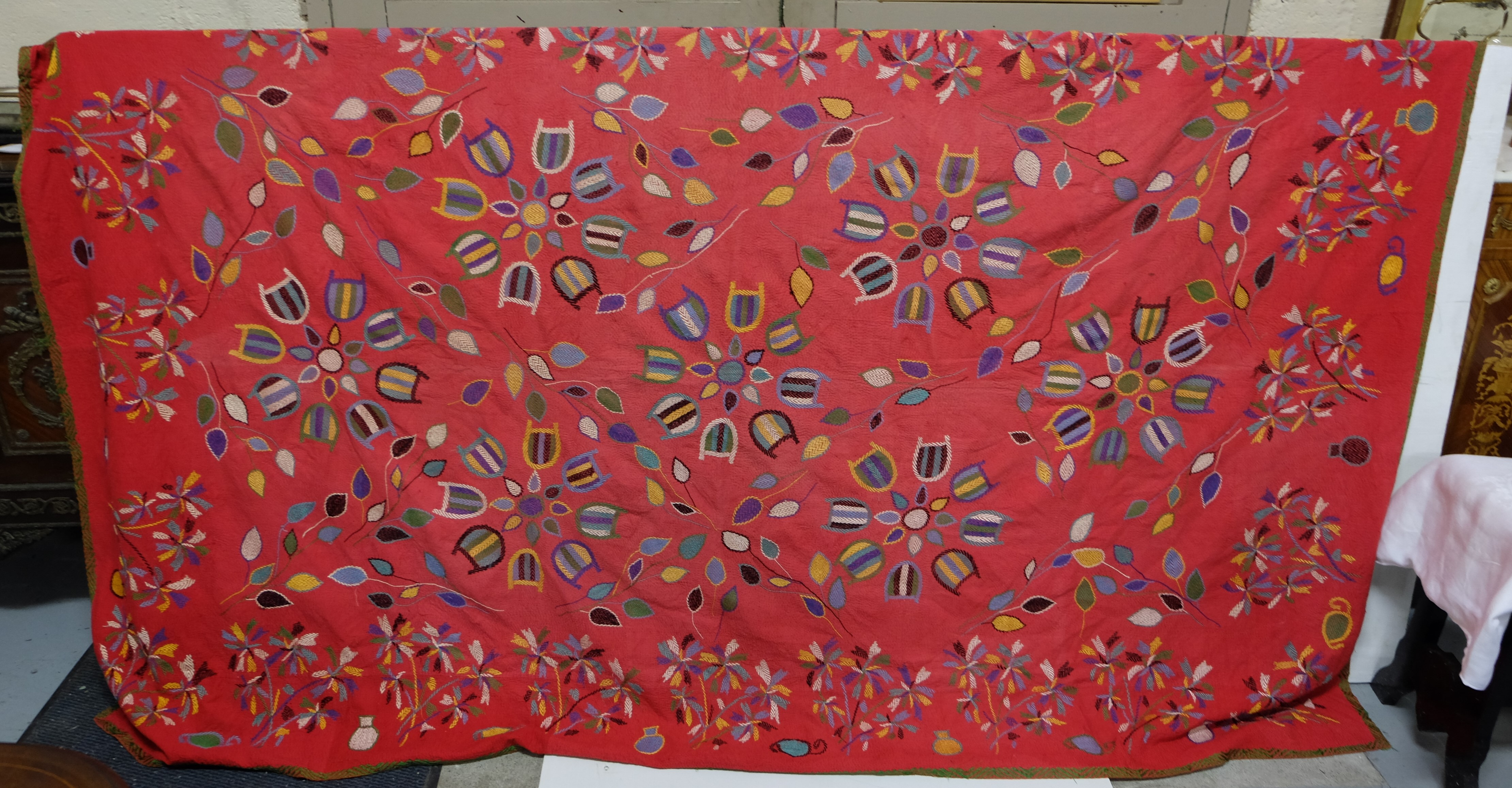 Lot 5 - Indian Hand Sewed Throw, red ground with multiple patterns, 5m x 2.2m
