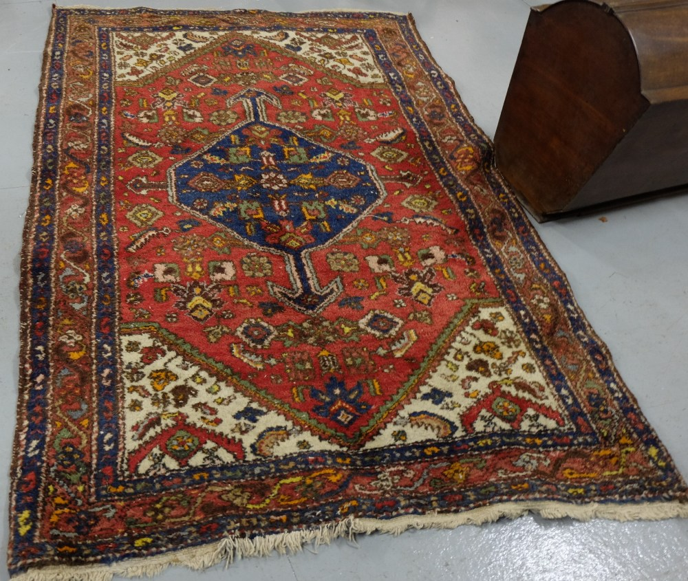 Lot 38 - Wool Floor Rug, red ground with navy and cream patterns around a central medallion, 1.3m x 2.0m