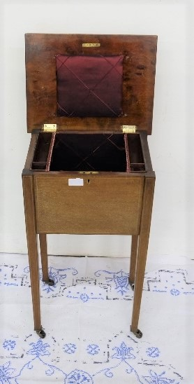 """Lot 7 - Edw. Sewing Box, on tapered legs, a hinged lid enclosing padded compartment, 15"""" w x 26""""h"""
