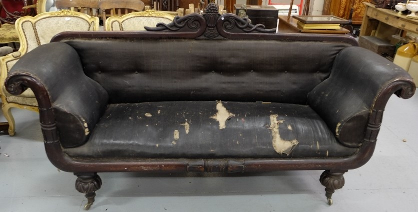 Lot 9 - WMIV Mahogany Framed Sofa, the back rail featuring an applied urn, scrolled side arms, on turned