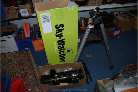 Skywatcher telescope nearly new complete with tripod, lenses.