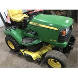 John Deere X748 compact tractor c/w mid mounted deck, reg. SF10 GZY When tested was seen to run