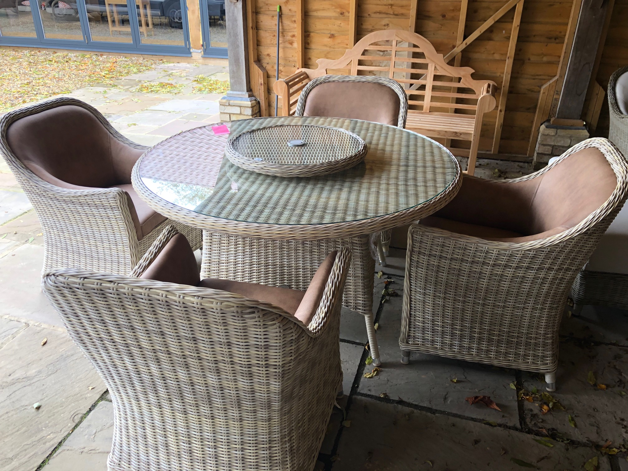 Lot 28 - A Bramblecrest Ascot dining set, 140cm round dining table, lazy Susan and four Monte Carlo frame