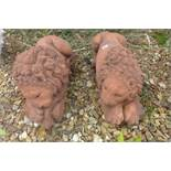 A pair of cast stone terracotta recumbent lions on rectangular bases, after canova, 45cm L x 19cm H
