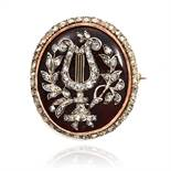 AN ANTIQUE DIAMOND AND GARNET BROOCH, EARLY 19TH CENTURY in high carat yellow gold, the oval body