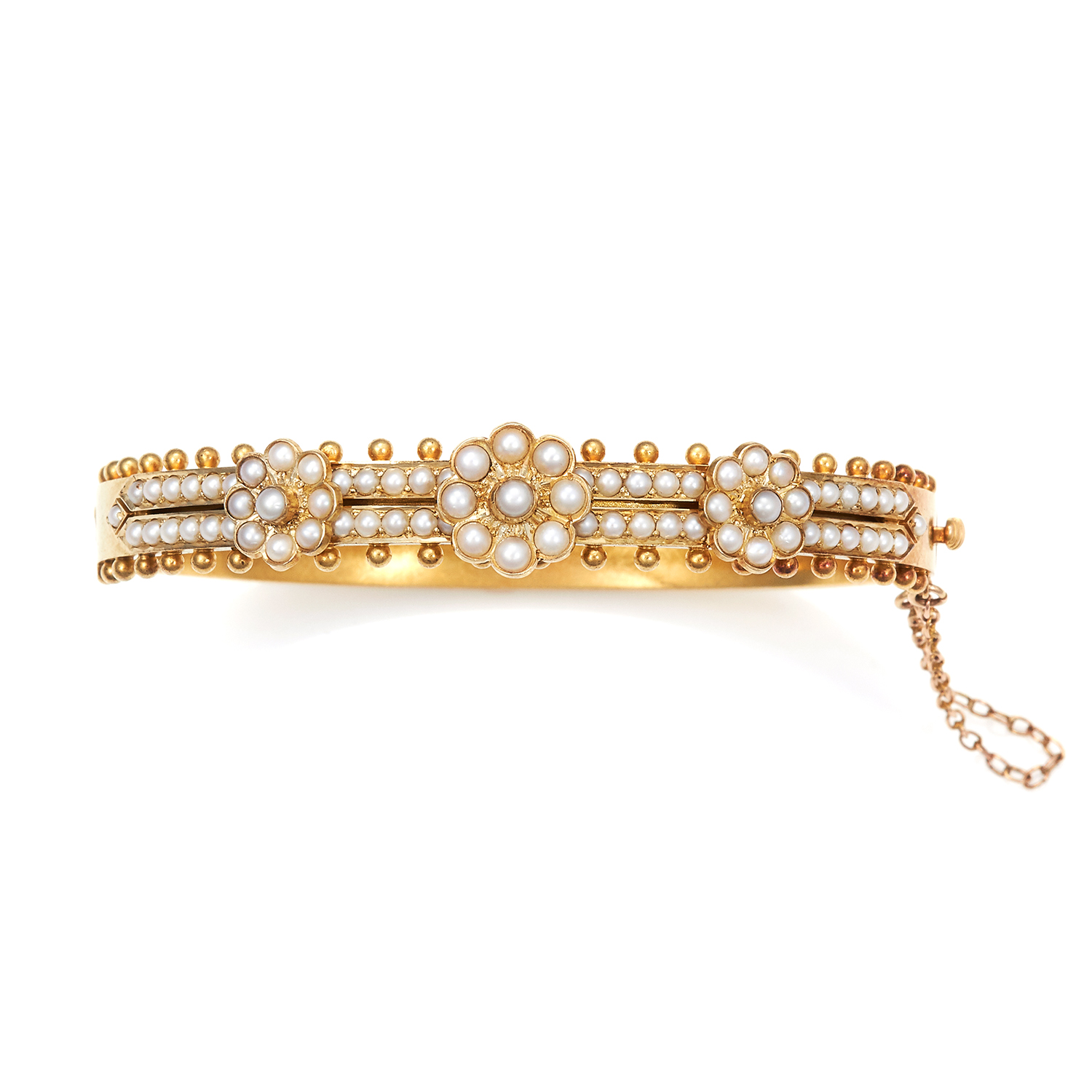 Los 1 - AN ANTIQUE PEARL BANGLE, 19TH CENTURY in high carat yellow gold, half jewelled with pearl cluster