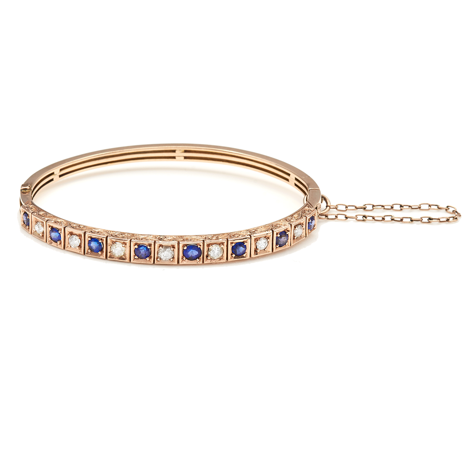 AN ANTIQUE SAPPHIRE AND DIAMOND BANGLE in 15ct yellow gold, a half hoop decorated with alternating
