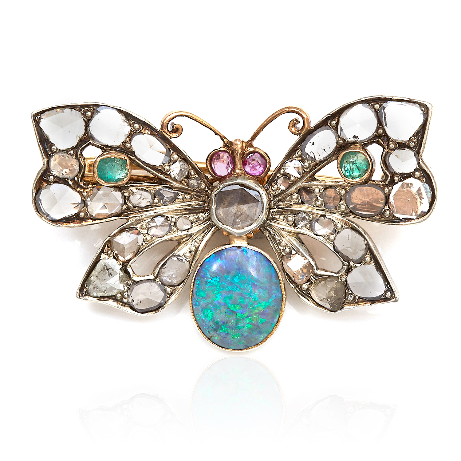 A VICTORIAN OPAL, DIAMOND, EMERALD AND RUBY BUTTERFLY BROOCH in yellow gold, set with a central