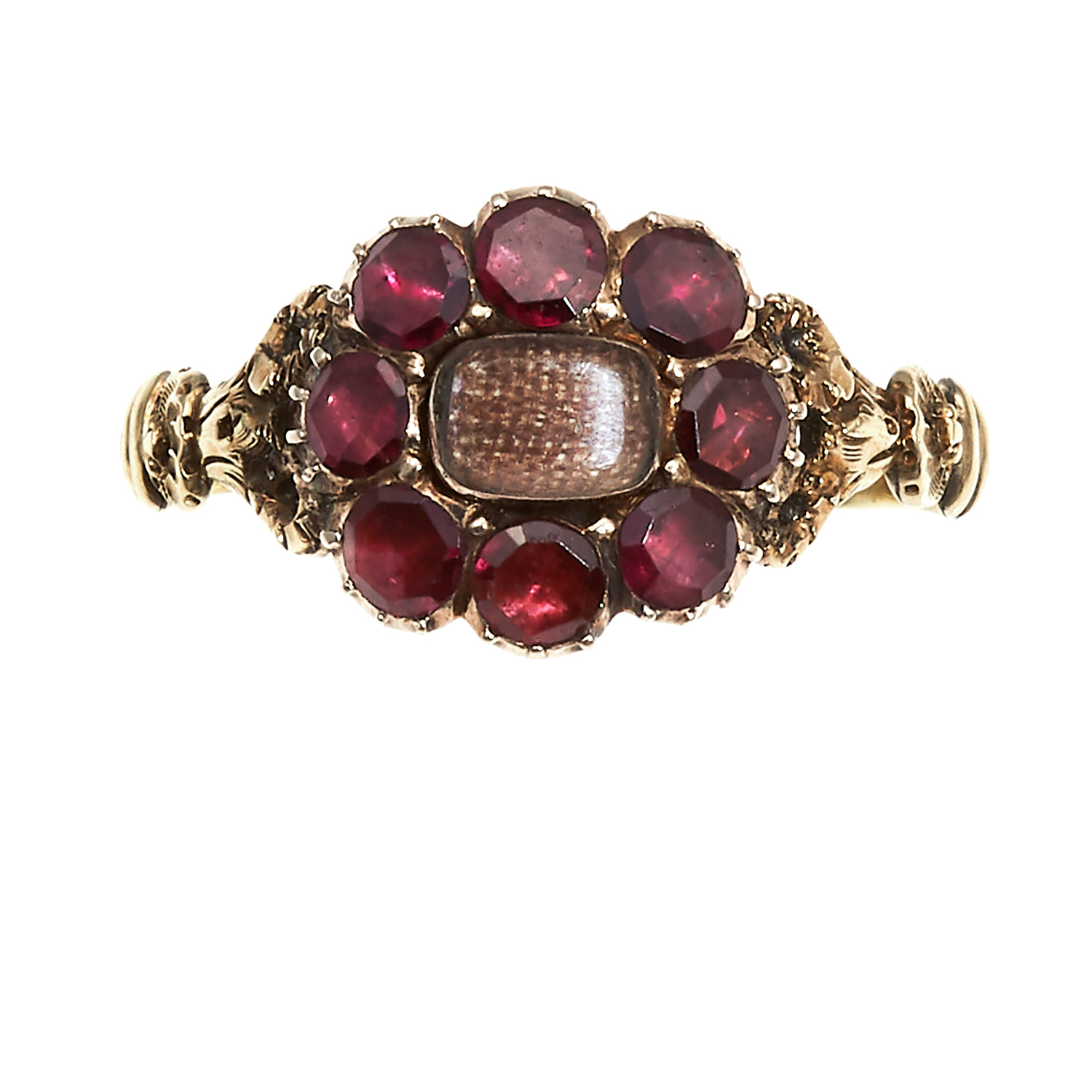 Los 46 - AN ANTIQUE HAIRWORK AND GARNET MOURNING RING in high carat yellow gold, set with a central panel