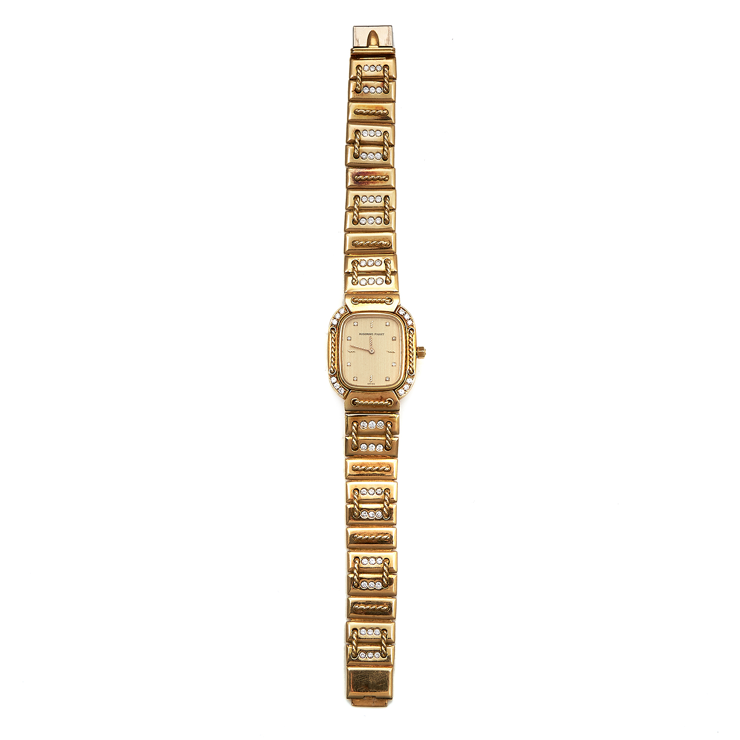 A LADIES DIAMOND WRIST WATCH, AUDEMARS PIGUET in 18ct yellow gold, the rounded rectangular 26mm case