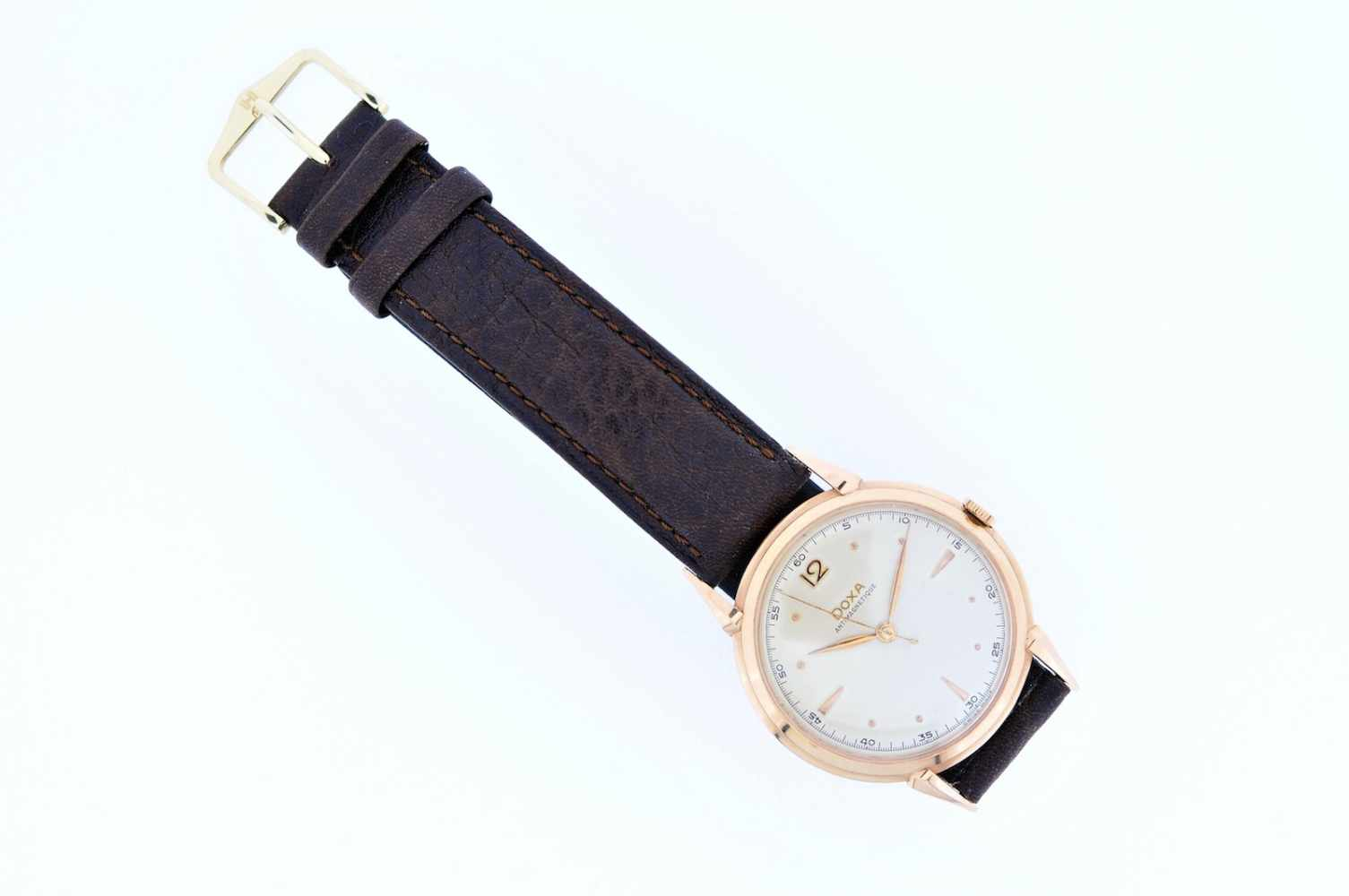 Doxa Roségoldene Armbanduhr an Lederband, Doxa Antimagnetique, Handaufzug, Ankerwerk,
