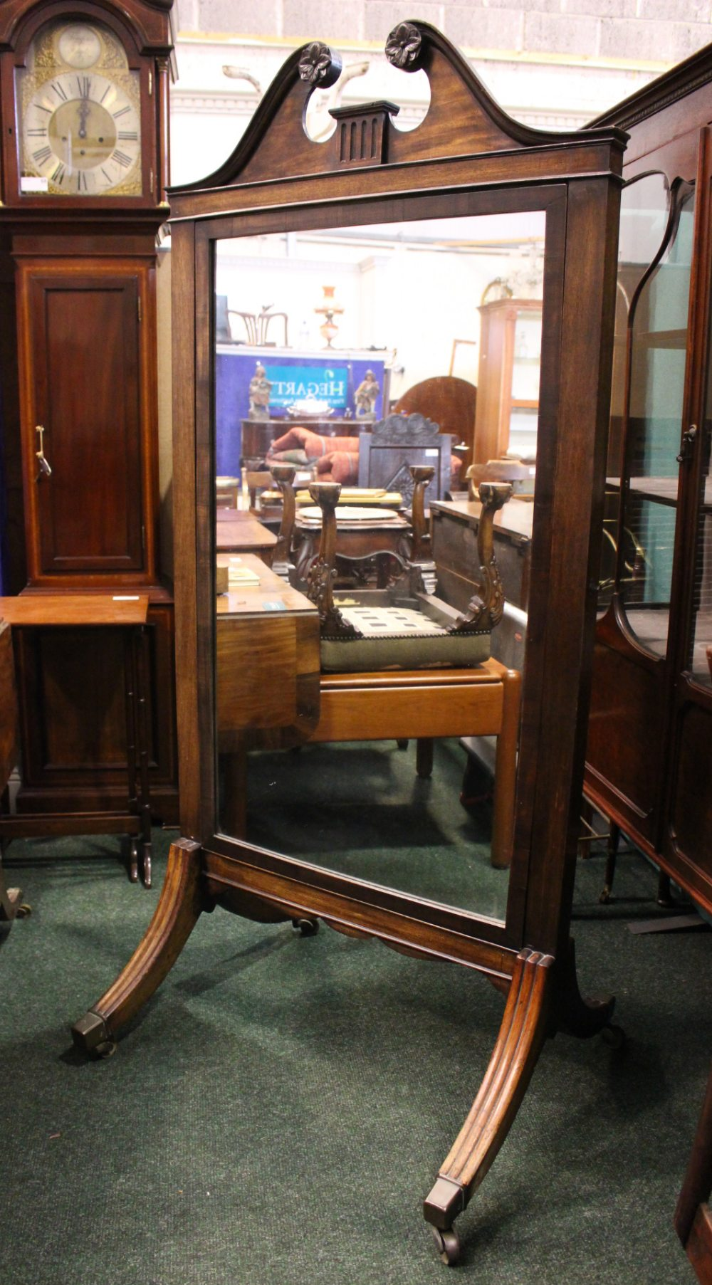 Lot 54 - A LARGE CHEVAL MIRROR, with swan neck pediment