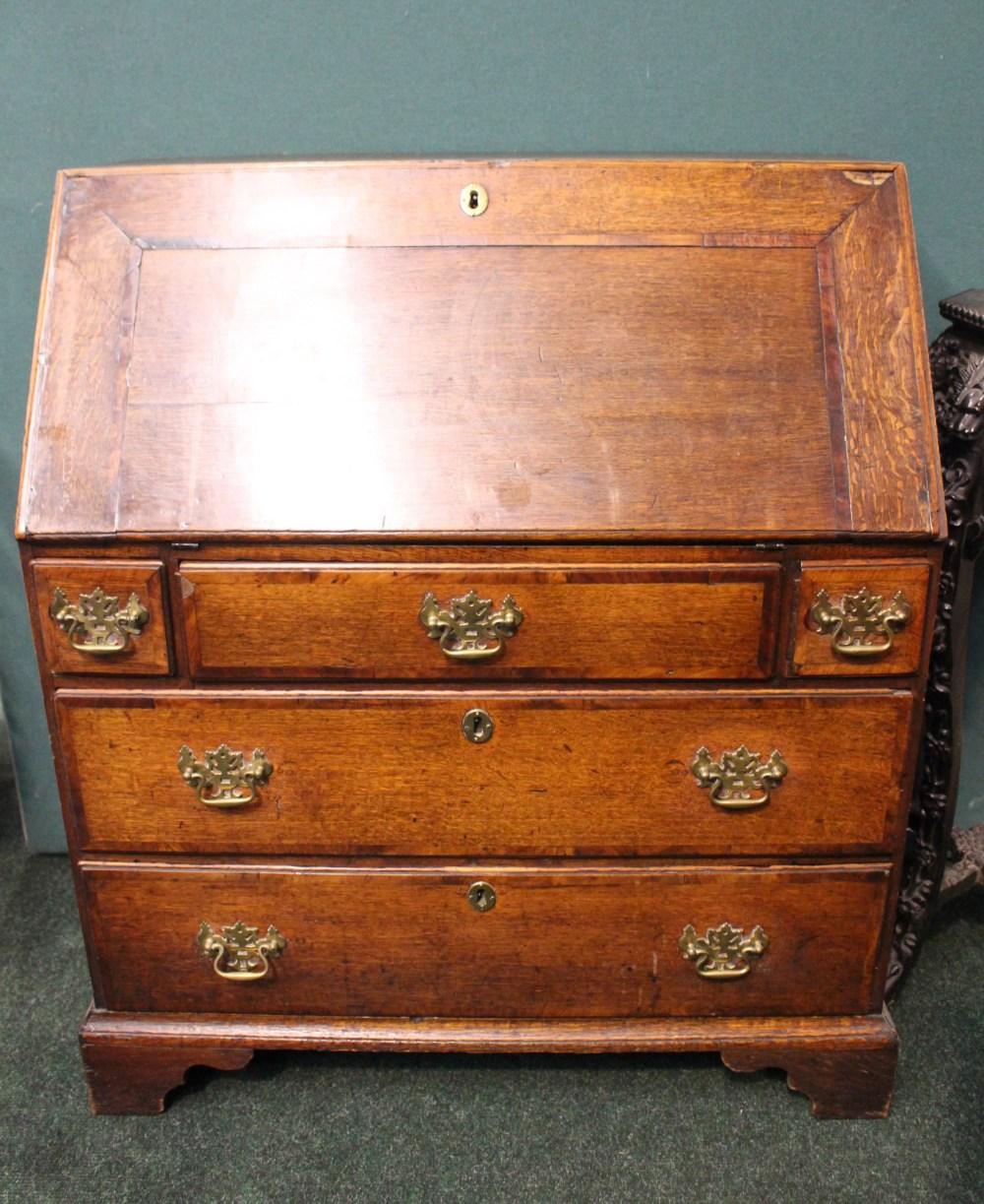 Lot 23 - A LARGE OAK BUREAU DESK/SECRETAIRE, 3 over 2 drawers, cross-banded drop down lid, opens to reveal