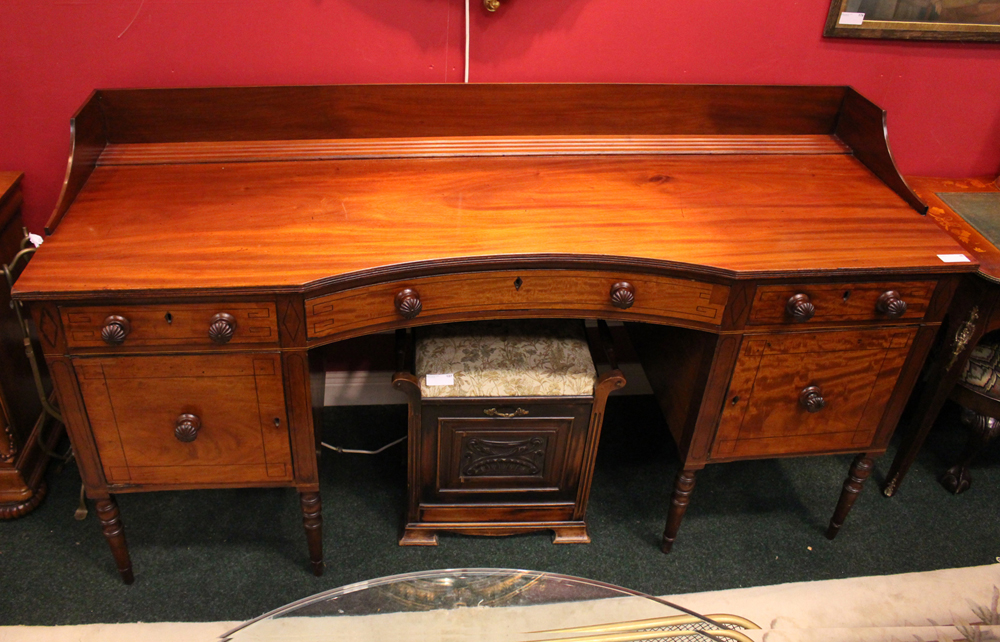 Lot 53 - A LARGE SIDE BOARD, decorated with ebonised detail to the front, a single central curved drawer,