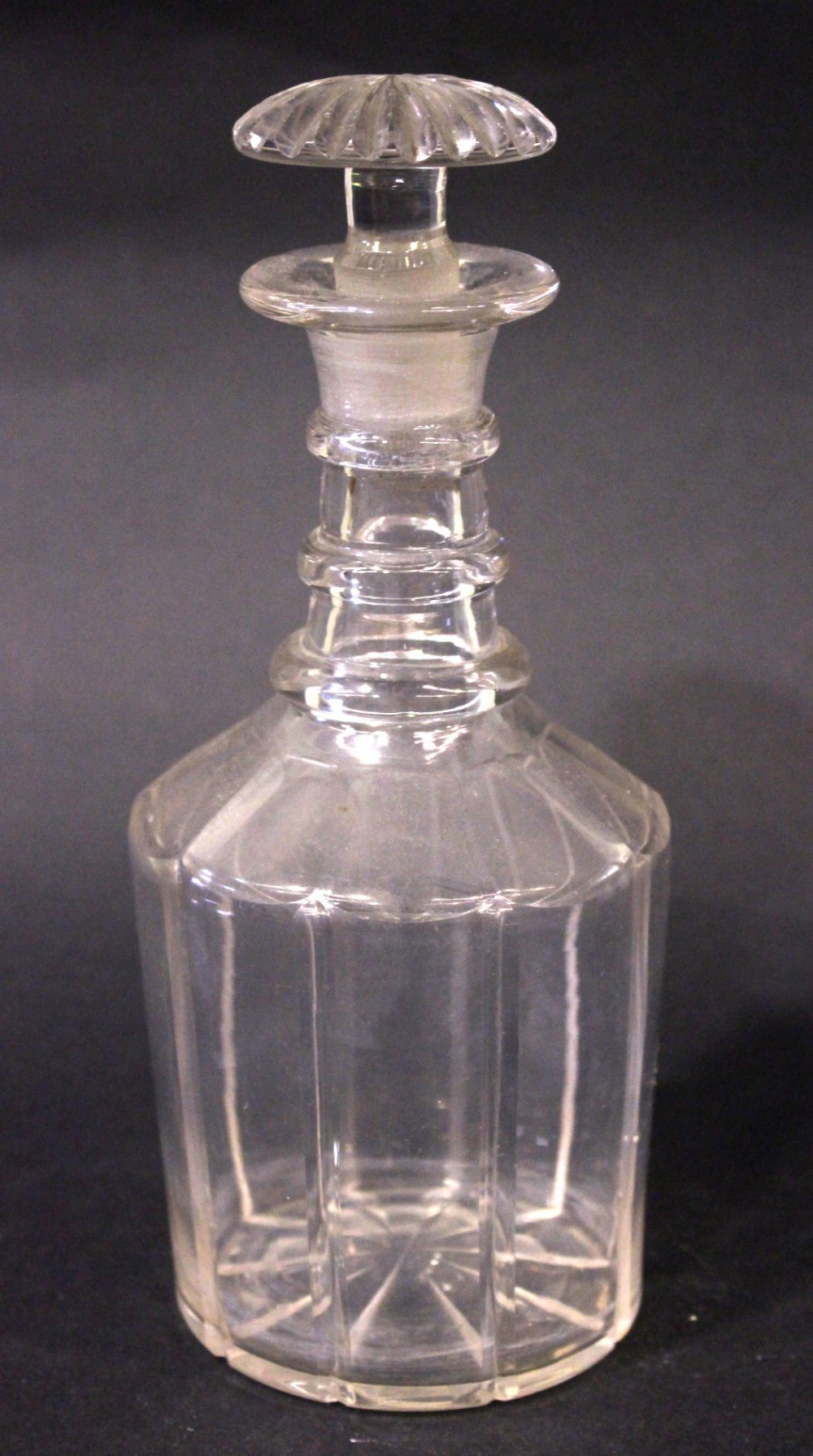 Lot 32 - AN IRISH, 19TH CENTURY, 3 RING NECK DECANTER, with stopper, starburst base, with wide fluted body
