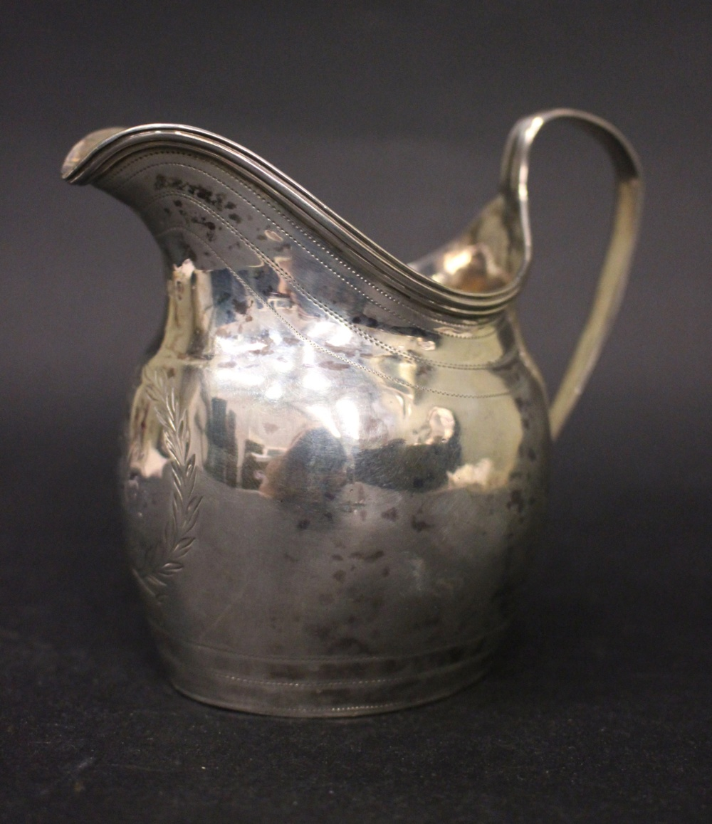Lot 16 - A FINE LATE 18TH CENTURY STERLING SILVER CREAMER, with reeded rim, and bands of bright cut