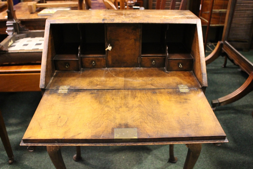 Lot 27 - A FINE WALNUT BUREAU DU JOUR, neat size, drop down front reveals cabinet with drawers, over a single