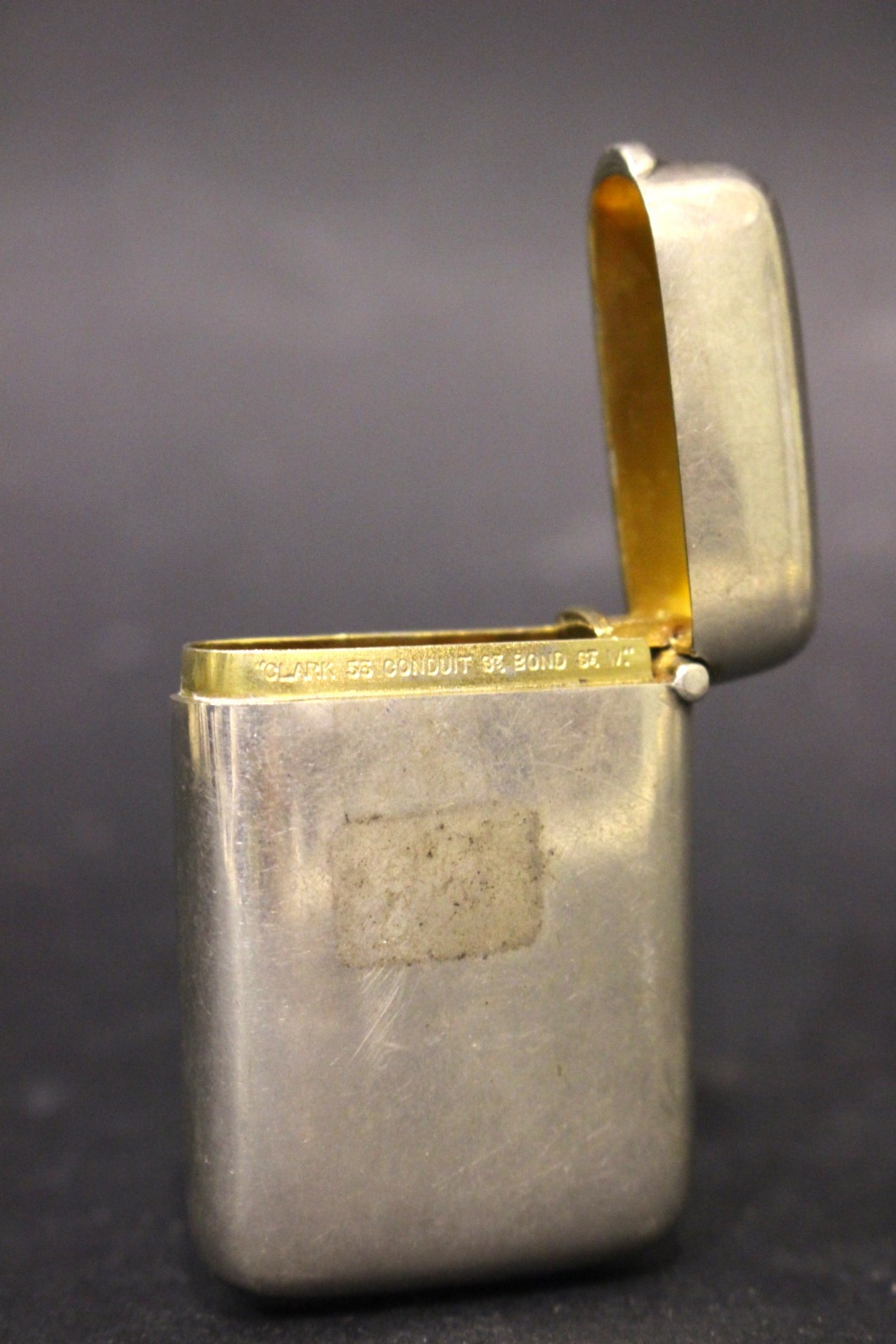 Lot 30 - AN EARLY 20TH CENTURY SILVER VESTA CASE, small, with gilt interior, maker's mark A.C