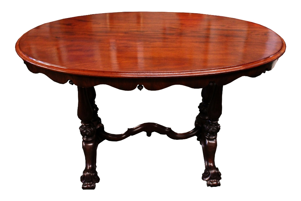 Lot 12 - A VERY FINE 19TH CENTURY OVAL SHAPED LIBRARY TABLE, with scalloped apron, and down turned finial