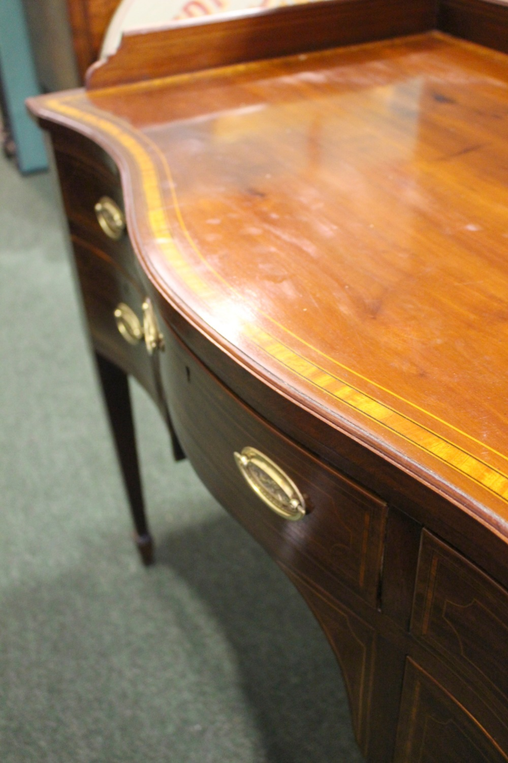 Lot 60 - A VERY FINE SERPENTINE SHAPED SIDE BOARD, with 5 drawers, canted front corners, raised on tapering