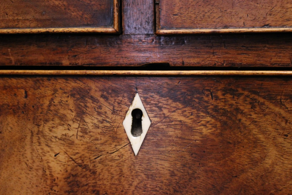 Lot 25 - A FINE BOW FRONTED CHEST OF DRAWERS, 2 over 3 drawers, with bone diamond shaped key plates