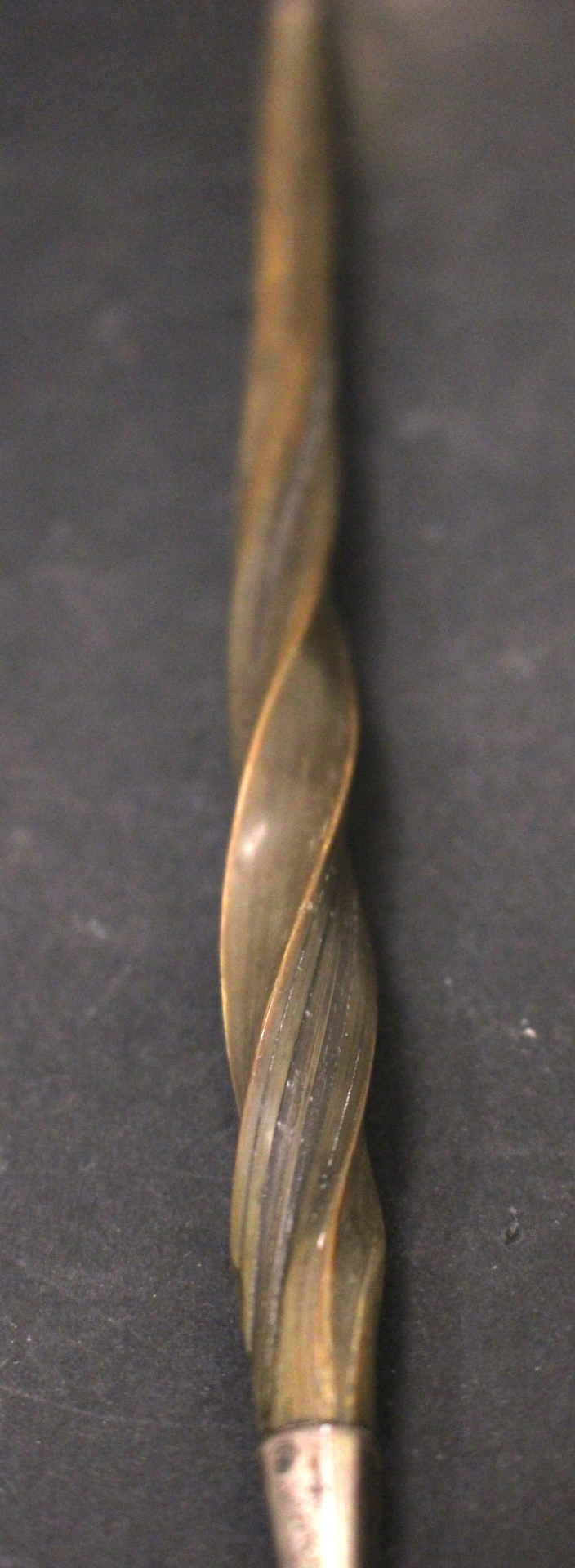 Lot 14 - AN EARLY 19TH CENTURY ENGLISH SILVER LADLE, with twisted 'Baleen'/bone handle, tipped with silver,
