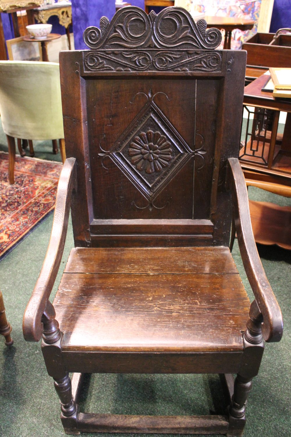"Lot 46 - AN OAK ""WAINSCOT"" ARMCHAIR, with square panel back, having carved top rail, and lozenge shaped"