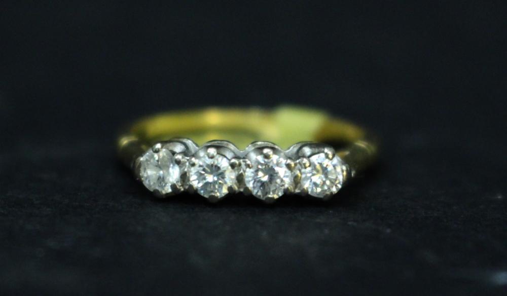 Lot 35 - AN 18CT YELLOW GOLD FOUR STONE DIAMOND RING