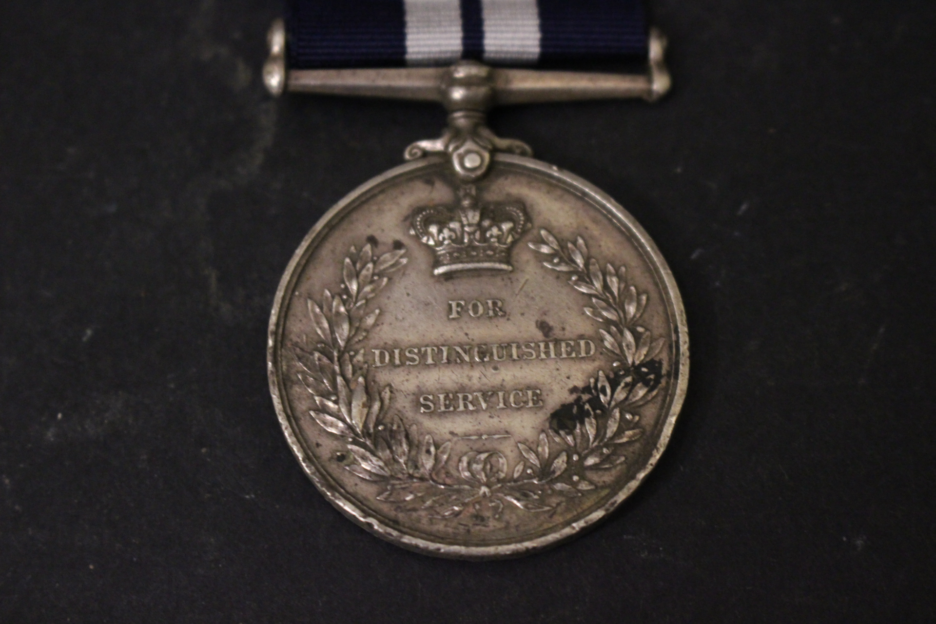 Lot 4 - A MEDAL FOR DISTINGUISHED SERVICE IN WORLD WAR I, awarded in May of 1916