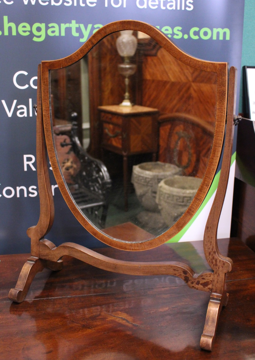 Lot 49 - A FINE EDWARDIAN TABLE TOP SWING MIRROR, with a shield shaped mirror