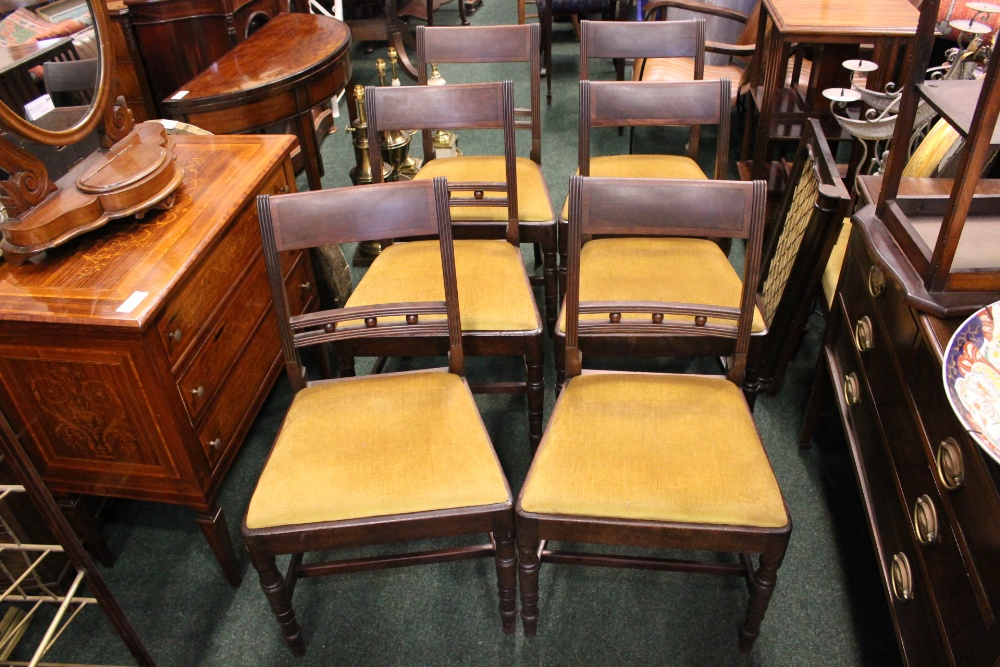 Lot 21 - A GOOD SET OF 6 REGENCY DINING ROOM CHAIRS, with reeded frame, having a ebonised string inlaid crest