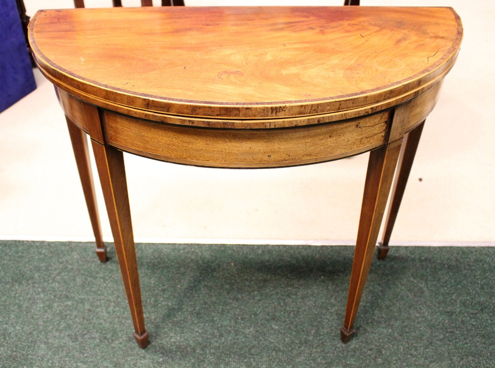 Lot 41 - A FINE EDWARDIAN DEMI LUNE FOLD OVER TEA TABLE, cross banded top, string inlaid legs and frieze,