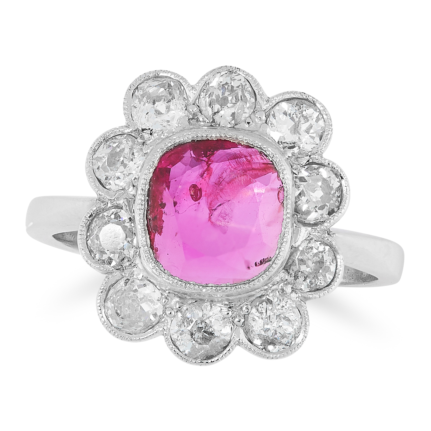 A BURMA NO HEAT RUBY AND DIAMOND RING CIRCA 1950 in platinum, set with a modified cushion cut ruby