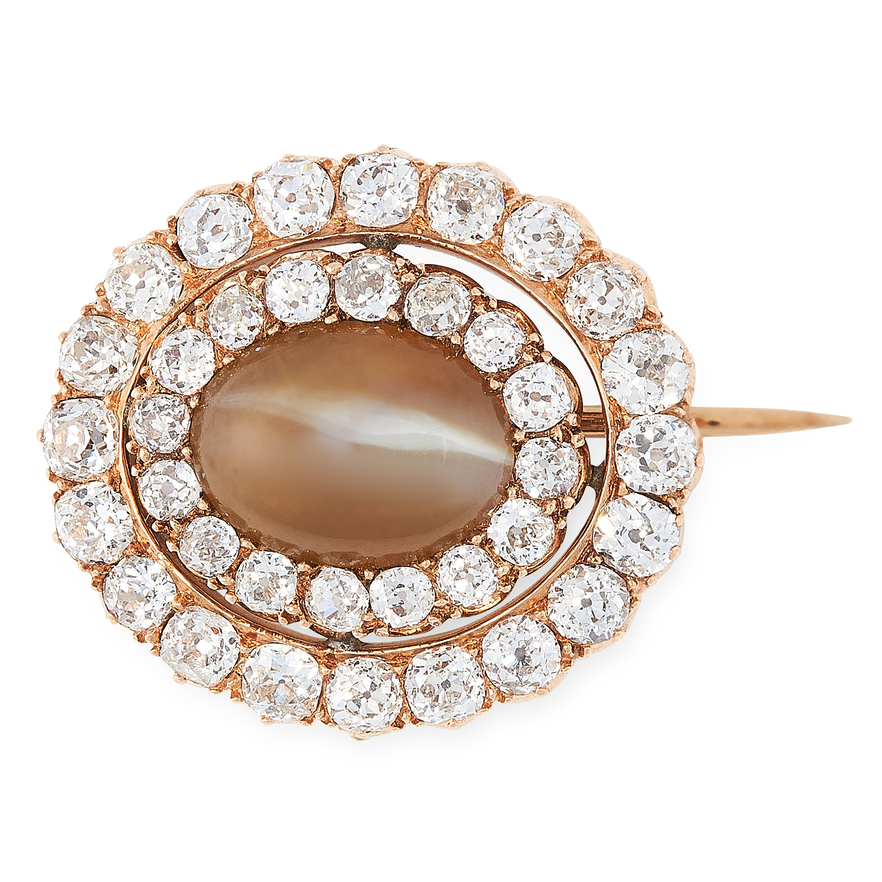 AN ANTIQUE CATS EYE CHRYSOBERYL AND DIAMOND BROOCH in high carat yellow gold, set with an oval
