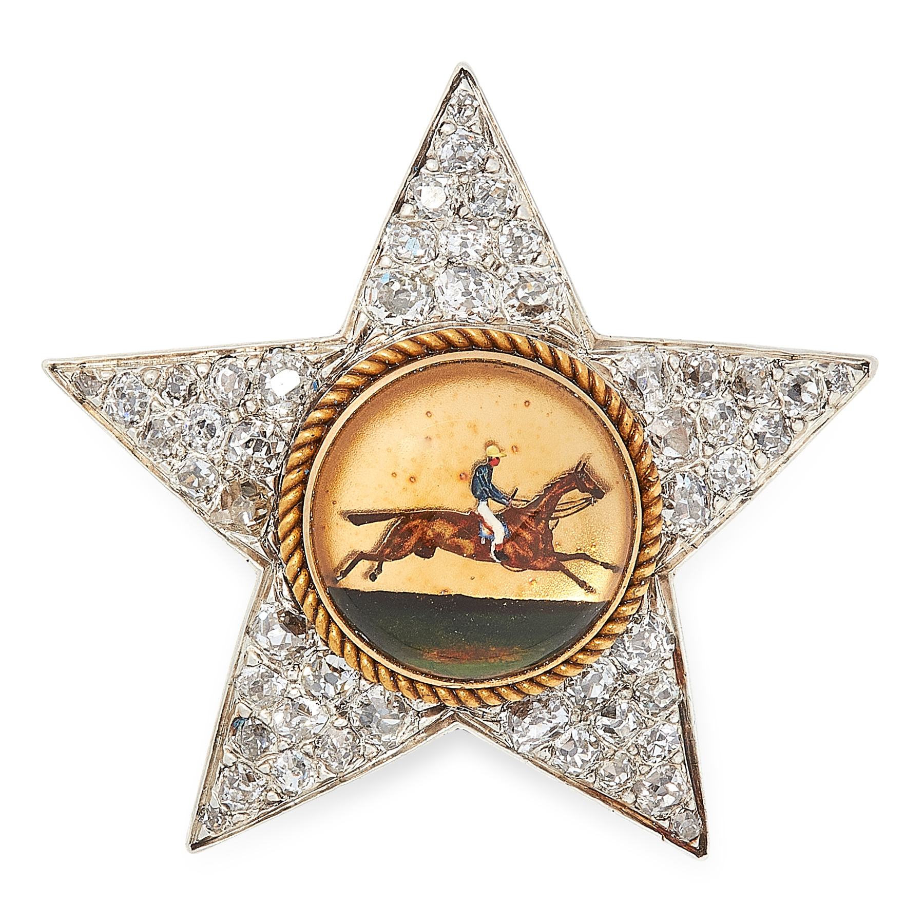 AN ANTIQUE REVERSE CARVED INTAGLIO AND DIAMOND BROOCH in yellow gold and silver, designed as a star,