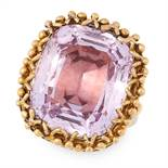 AN ANTIQUE PINK TOPAZ RING in 18ct yellow gold, set with a cushion cut pink topaz of 20.25 carats