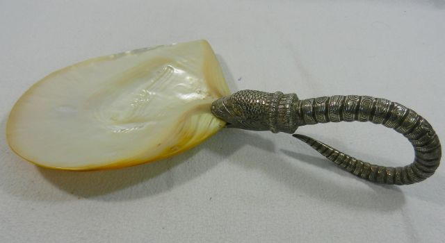 Lot 298 - A Cambodian gold lipped oyster shell with silver handle in the form of a mythical sea creature