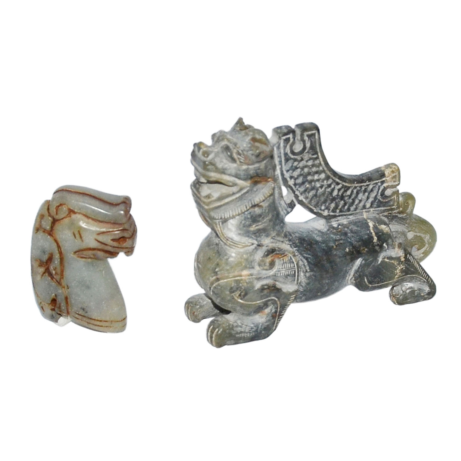 Lot 23 - 玉雕龍頭獸身、馬頭伏獸一組二件 Two Carved Dark Jade Mythical Beasts Ornaments  Height: 3¾ in (9.5 cm), 2½ in (6.4