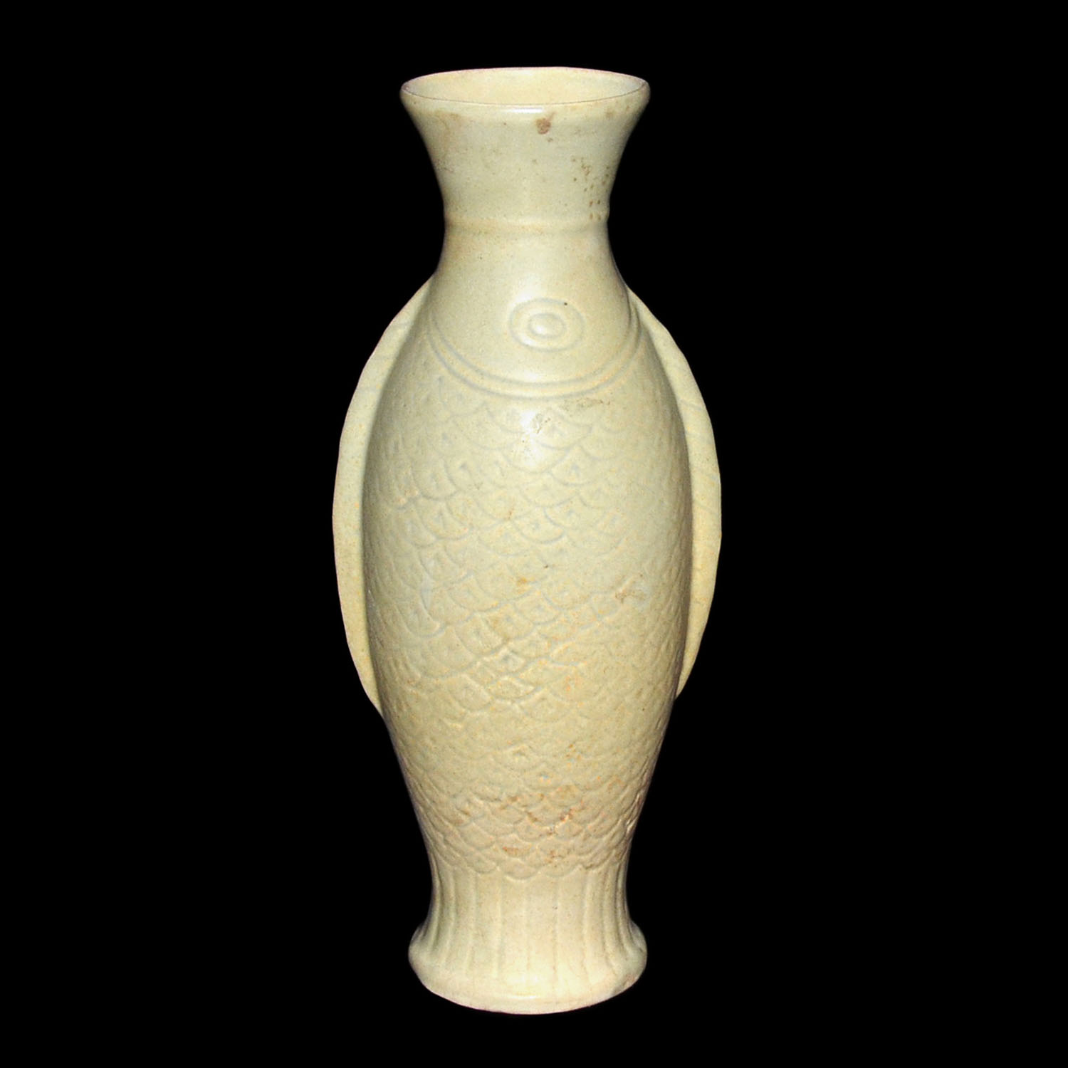 Lot 185 - 宋 定窯稀有白釉刻花魚瓶 Song, A Rare Dingyao Fish-Form Vase Incised with fish scales and flanked by fin-