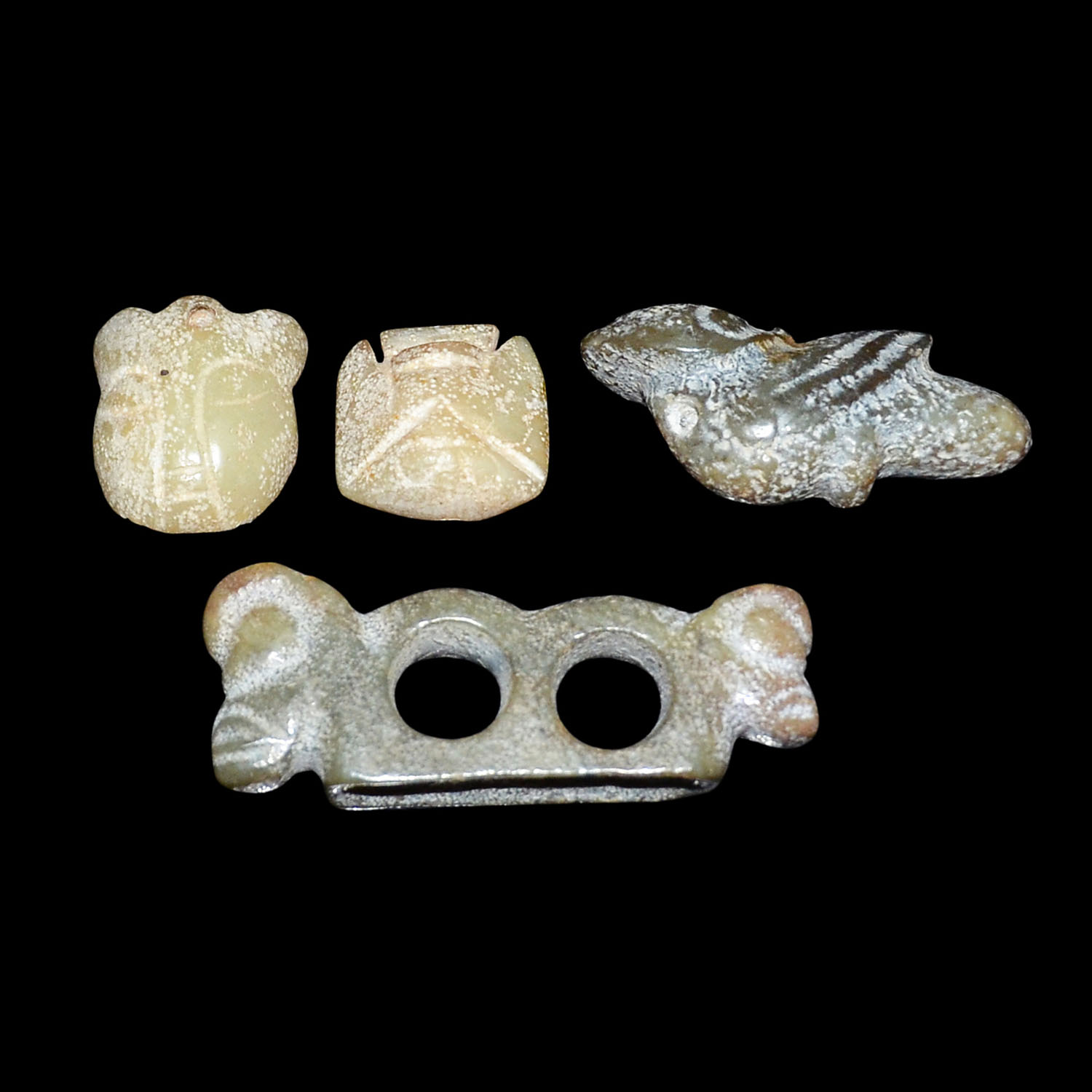 Lot 22 - 紅山文化玉雕人、鳥、獸紋一組四件 A Group of Four Neolithic Hongshan Culture Jade Carved Ornaments  Total Weight: 108