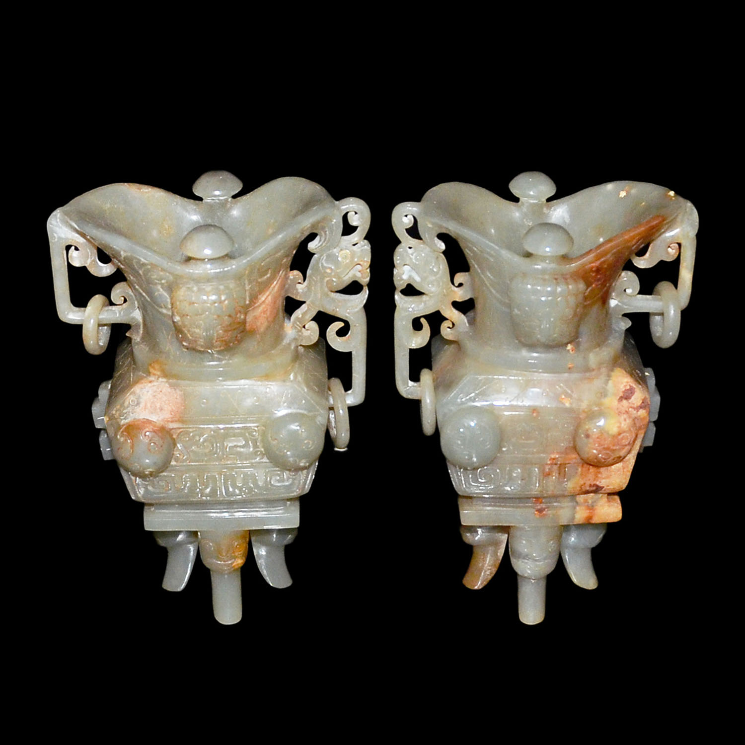 Lot 207 - 玉雕獸面紋活環四足方爵杯一對 A Pair of Carved Ceremonial Jade Jue with Taotie Masks, Loose Rings and Four