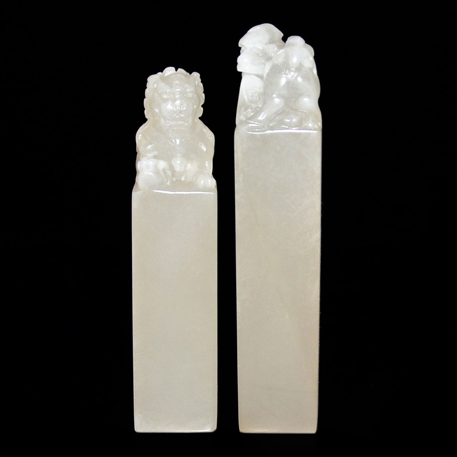 Lot 55 - 芙蓉石荔枝凍獅鈕印料兩件 Two Translucent Furong Stone Seals Carved with Lion Knob  Height: 5 in (12.7 cm), 5⅝ in