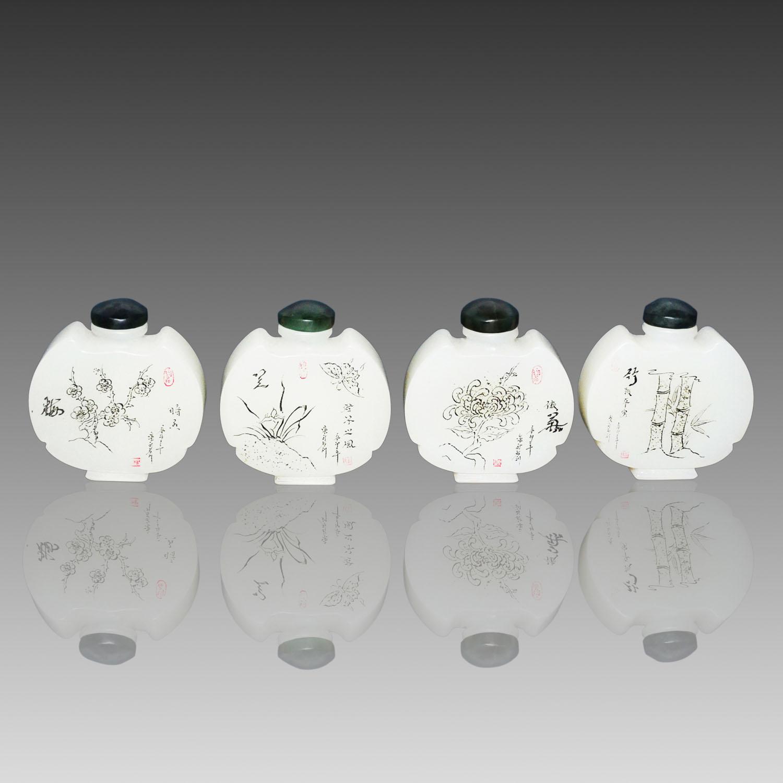 Lot 41 - 白翠玉梅蘭菊竹蝠祥(翔)鼻煙壺一套四件 A Set of Four White Jade Flask Snuff Bottles Auspicious shaped as Bat each