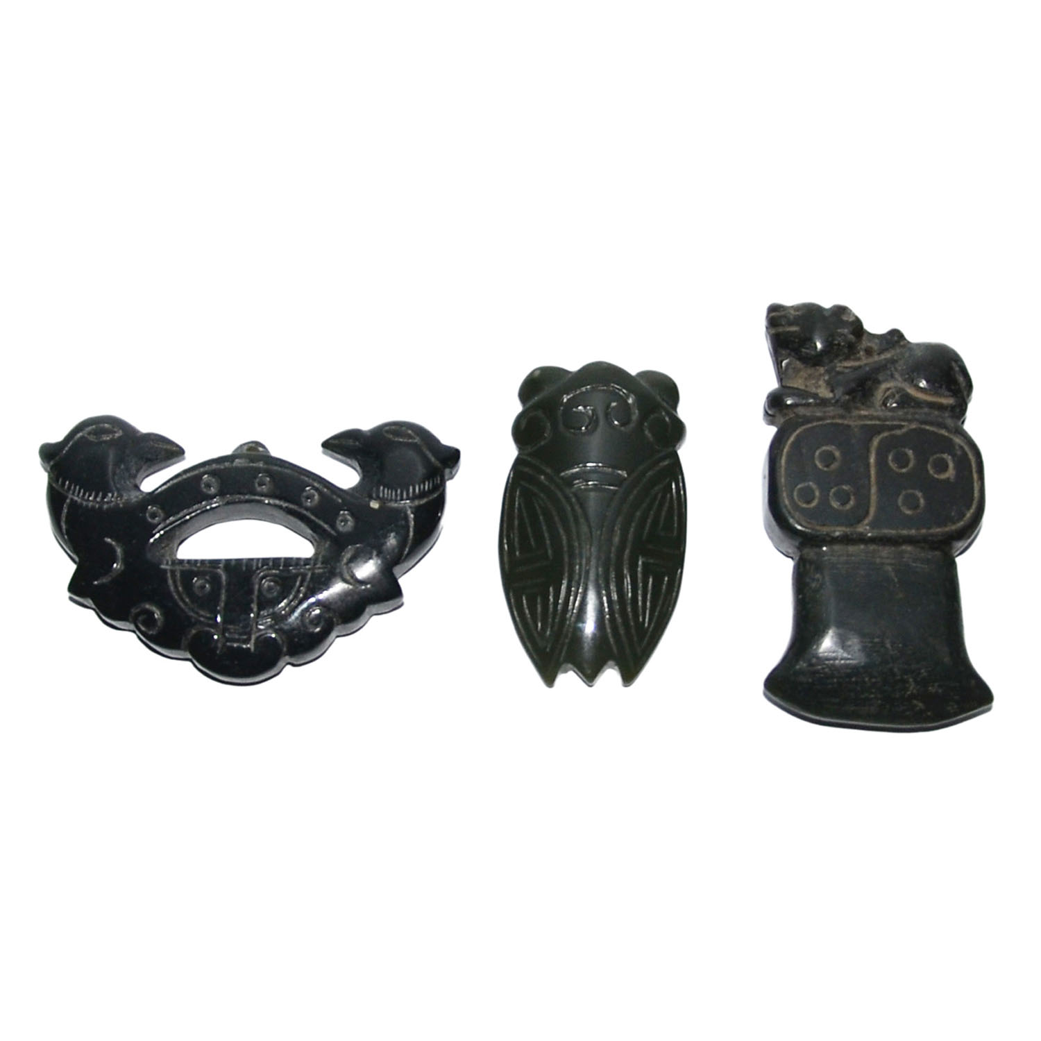 Lot 31 - 墨玉雕鳥、蟬、斧一組三件 Three Dark Jade Carved Ornaments: Cicada, Mythical Bird and Ritual Ax  Length: 2⅜ in (6