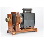A British-made Coronet Horizontal Enlarger, with unmarked brass lens, body, VG, converted to