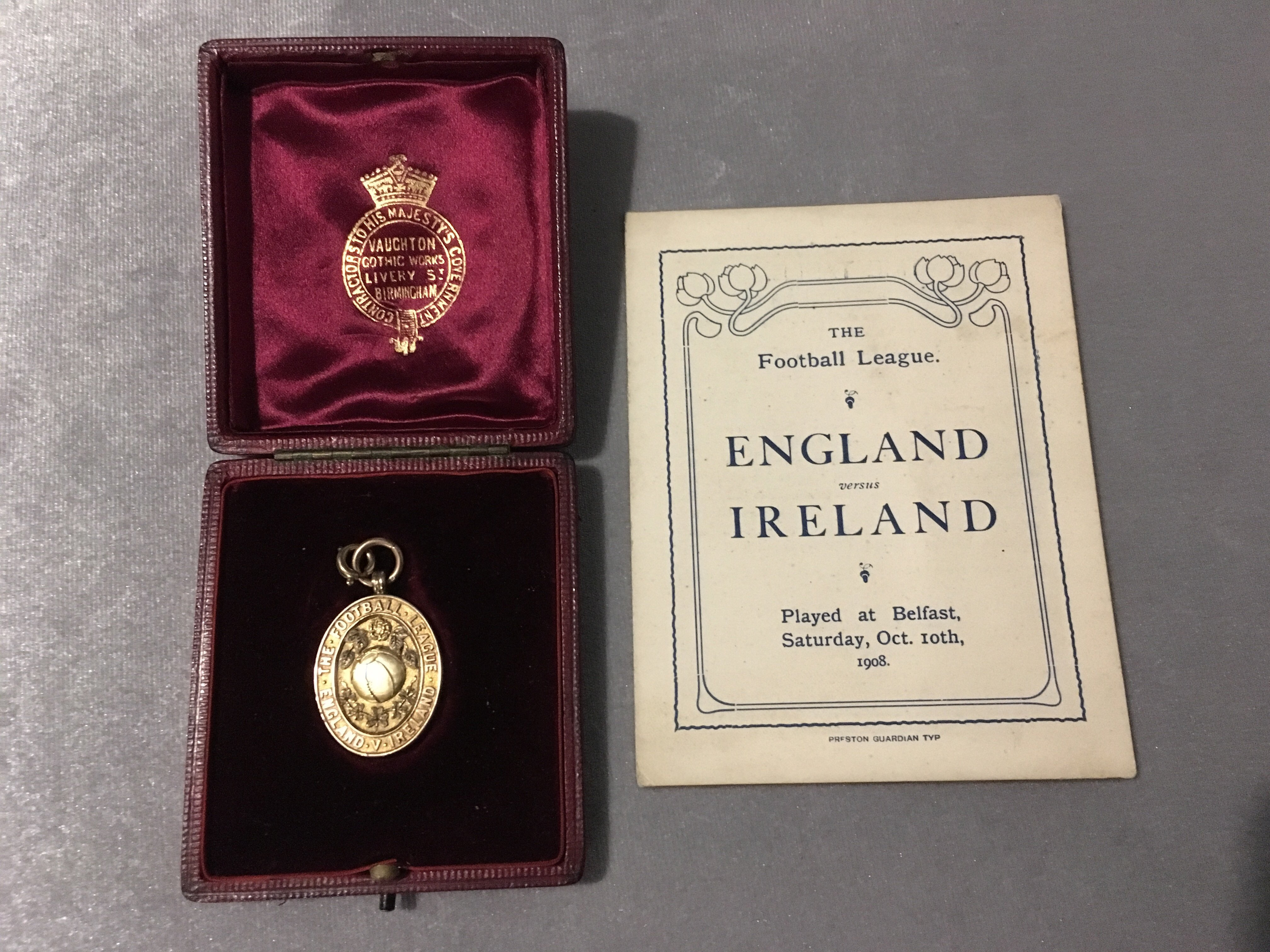 1908 England Football League Medal + Itinerary: Superb gold Vaughons medal in original box. The rear