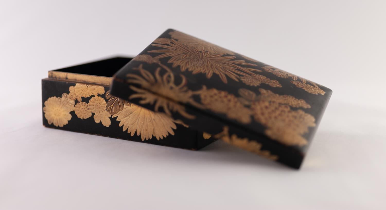 "Lot 39 - A JAPANESE MEIJI PERIOD SMALL LACQUERED BOX, gilded with chrysanthemum, 4 3/4"" (12cm) long"