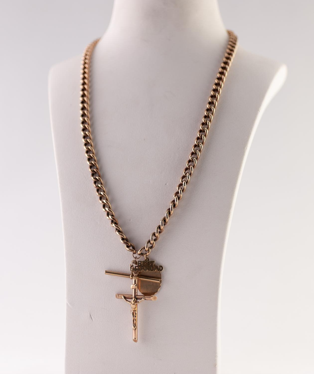 Lot 217 - GRADUATED CURB LINK ALBERT CHAIN, with T-bar, clip, stamped '375', length 52.5cm, suspending a
