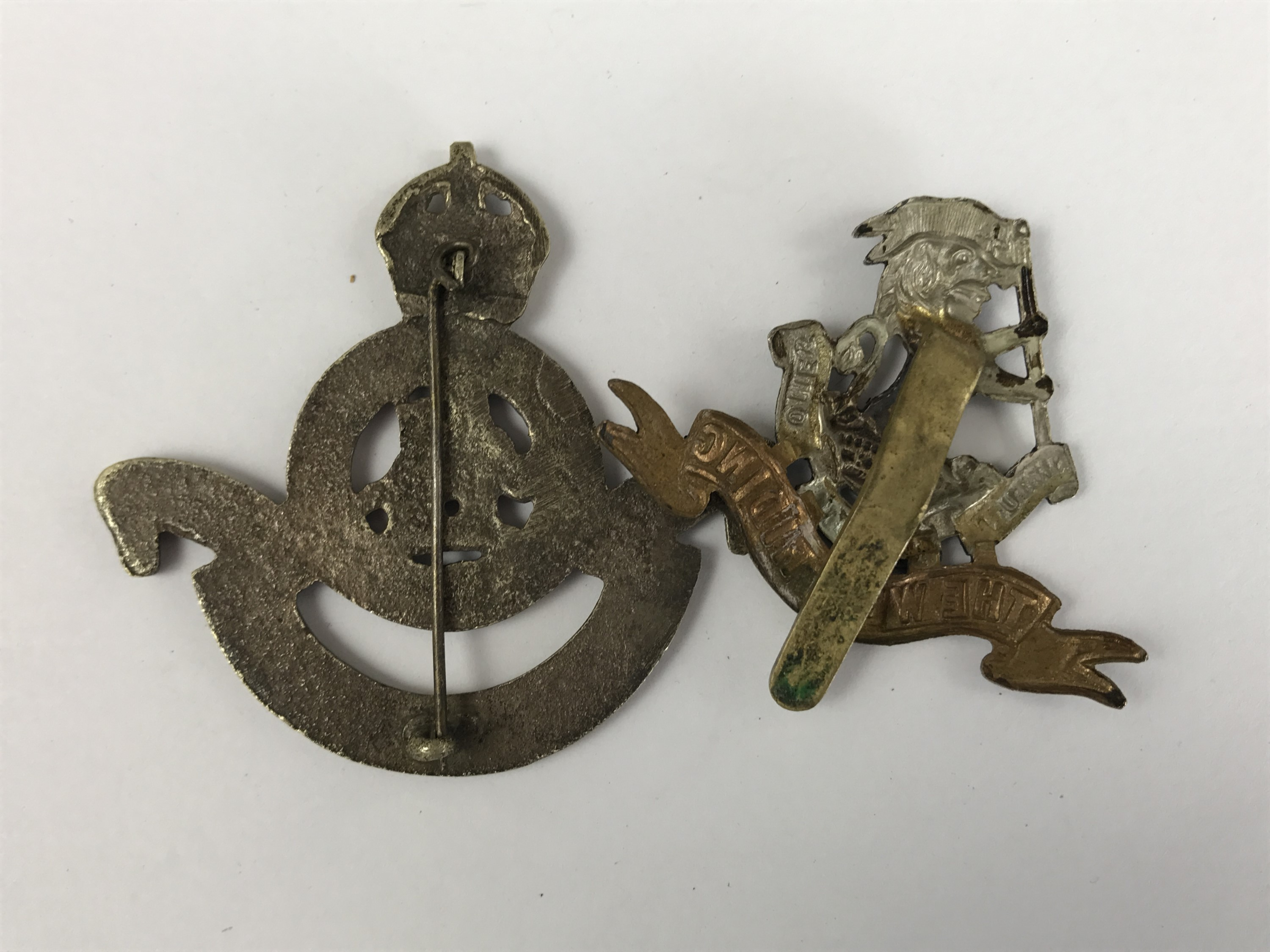 Lot 55 - An Indian-made cast-brass 2nd Battalion Duke of Wellington's Regiment cap badge, together with one