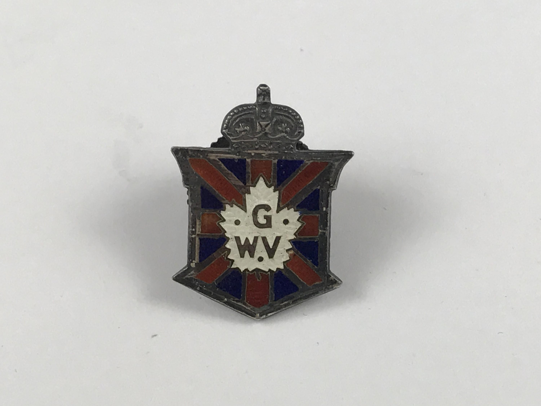 Lot 52 - A Great War Veterans Association enamelled white-metal lapel badge, marked 'sterling'